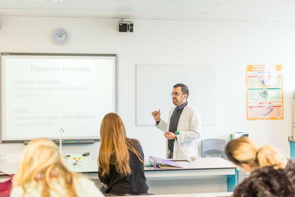 Tutor teaching in classroom
