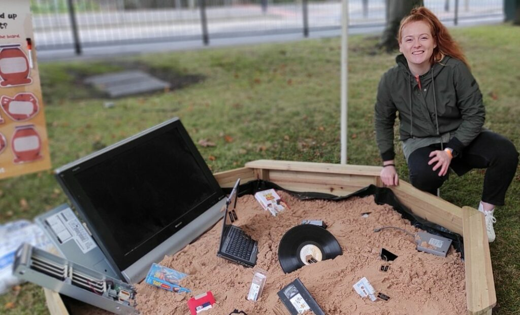 Tiffany Mazza of Ortial with a display highlighting the waste involved in obsolete technology